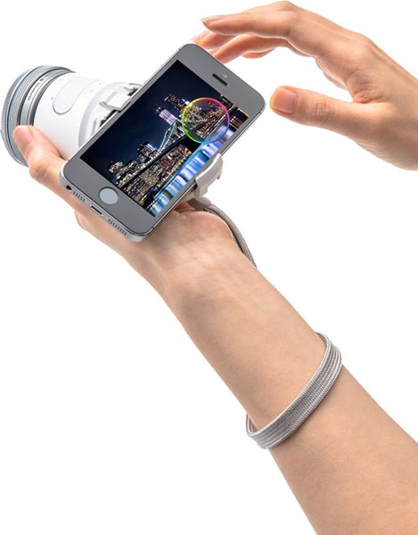 Olympus AIR A01 with lens and smartphone attached