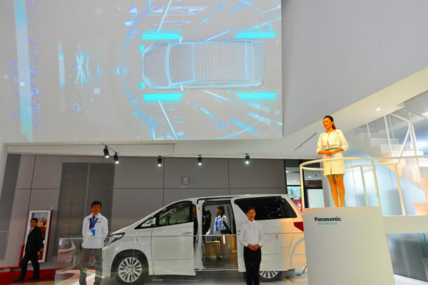 Panasonic's next generation concept car on the presentation stage with 3D projection mapping. Image courtesy of Panasonic.