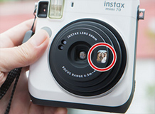 Fujifilm INSTAX Mini 70, Moon White color: Front-facing Selfie Mirror. Image Courtesy of Fujifilm