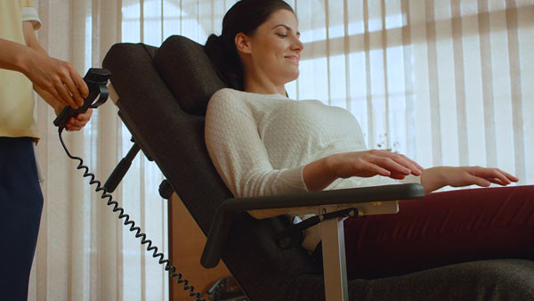 A combination of electric nursing care bed and an electric full reclining wheelchair: Resyone's bed splits in half and one half transforms into a reclining wheelchair. (Photo: Business Wire)