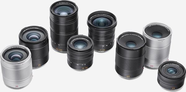 Leica TL-System's Lenses (left to right): Summilux-TL 35 mm f/1.4 ASPH (silver and black), APO-Vario-Elmar-TL 55–135 mm f/3.5–4.5 ASPH. (black), Vario-Elmar-TL 18–56 mm f/3.5–5.6 ASPH. (black), Super-Vario-Elmar-TL 11–23 mm f/3.5–4.5 ASPH. (black), APO-Macro-Elmarit-TL 60 mm f/2.8 ASPH. (black and silver), Summicron-TL 23 mm f/2 ASPH (black)