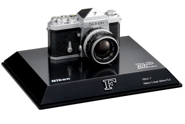 Nikon 100th Anniversary Miniature Nikon F Camera with detachable lens and back, and a loadable dummy film cartridge