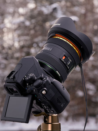 At the front of the HD PENTAX-DA★11-18mmF2.8ED DC AW lens is a groove where the heater can be installed. Above, lens with a cable-type lens heater installed: Image Courtesy of Ricoh