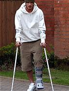 Photo of David Beckham wearing a reusable plastic cast walker