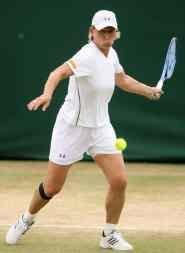 Navratilova of US plays a shot to China's Yan Zi and Zheng Jie during women's quarter-final doubles match in London