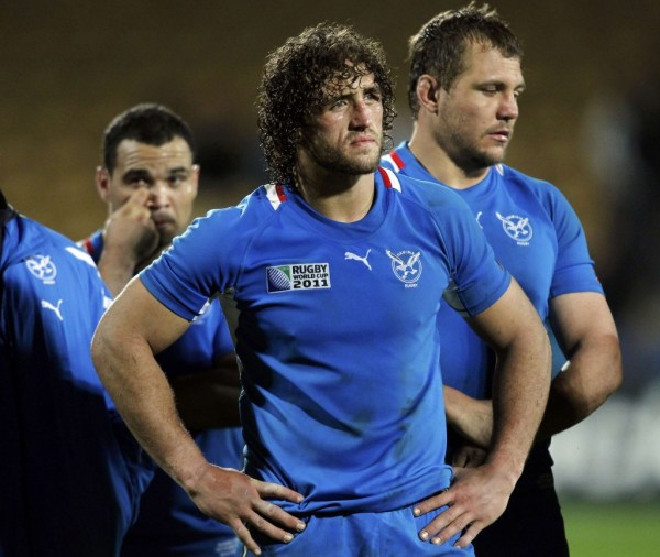 Namibia captain Jacques Burger and teammates react after losing their Rugby World Cup Pool D match against Wales at Stadium Taranaki in New Plymouth