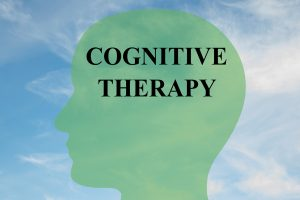 Render illustration of COGNITIVE THERAPY script on head silhouette with cloudy sky as a background. Human brain concept.