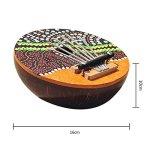 Doigt de coquille de noix de coco 7 clés Tambourin Kalimba Modèle aléatoire