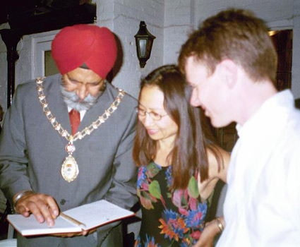 Mayor of London Ealing signs guest book after a concert, 2003