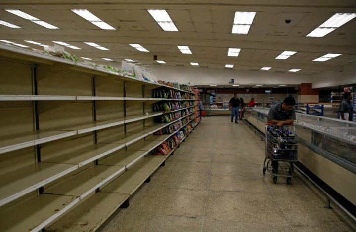 people-buy-food-and-other-staple-goods-inside-a-supermarket-in-caracas-venezuela-june-30-2016