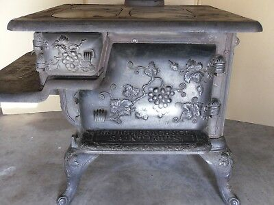 cast iron kitchen stove area rugs walmart bridge beach co st louis banner mohawk
