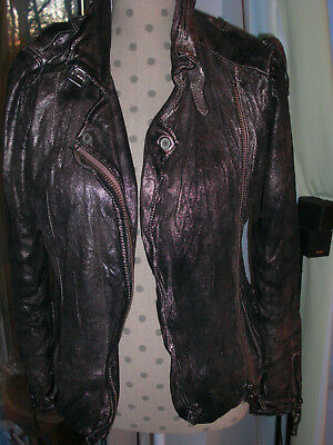 Original leather jacket by Montgomery in black and gold, shiny, size.  14/164