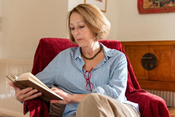 How to self publish a poetry book: Photo of a woman reading