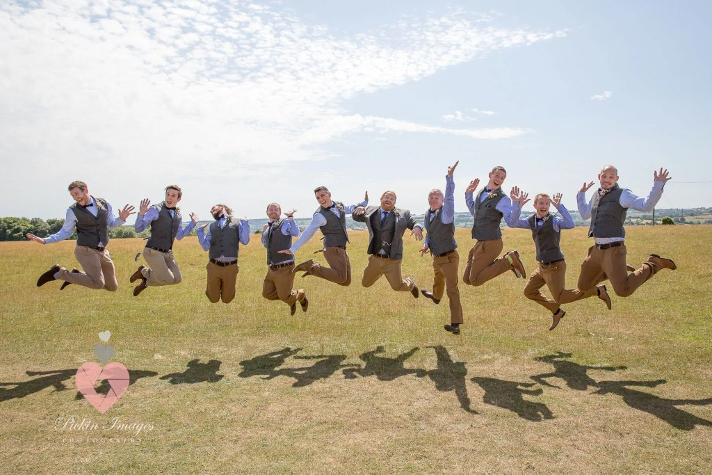 The groomsmen all jumping, same height funny faces