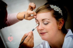 Bride being made up for her wedding data Spittleborough Farm wedding photography by pickin images photography