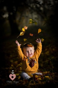 Westonbirt photoshoot with little boy playing in the leafs. Swindon family portrait photographer