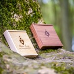 USB presentation boxes in a bluebell wood