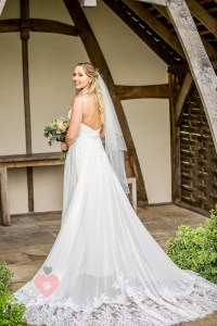 Beautiful wedding dress on a newly wed bride. Posed and shot by pickin images photography swindon.