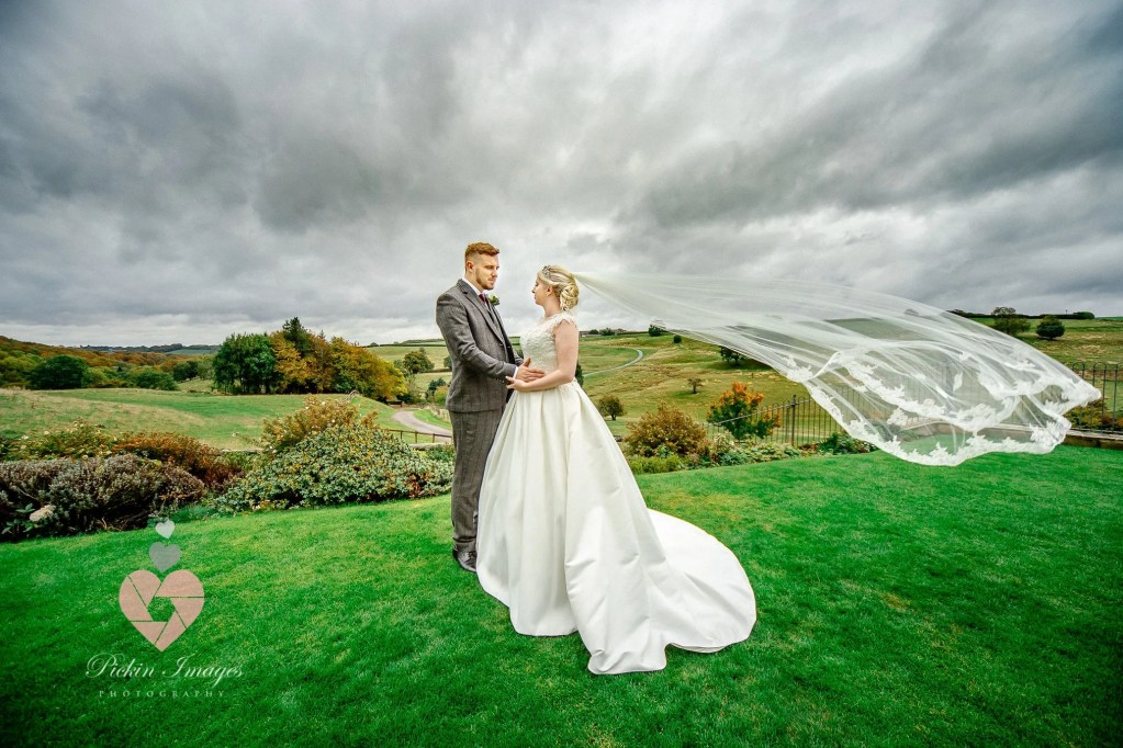 bride and groom in front of stunning sky