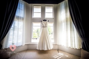 Wedding dress hung up ready for photographer pickin images for photos.