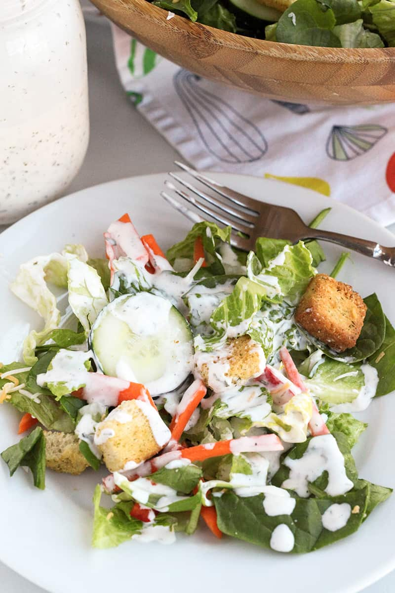 salad plate with salad and ranch dressing
