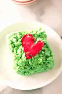 piece of grinch marshmallow treat on a white plate