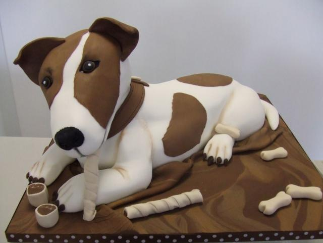 Chocolate and white dog cake scuplture