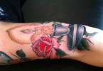 Latest Black Blue And Red Color Ink Burning Candle Tattoo On Arm Joint For Boys