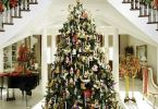 Wonderful Home Decorated With Flowers and Nice Christmas Tree Gifts