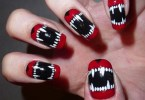Eye Catching Red And Black Nails With The Teeth Design