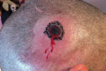 Great Gun Shot Tattoo On Head For Boys