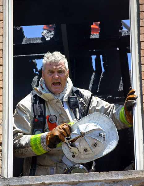 08/07/2015-Boston,MA. Joe Casper, Boston fire dept. acting District Chief, works at the scene of a 3 alarm fire at 6 Waverly St. in Roxbury today. Staff photo by Mark Garfinkel