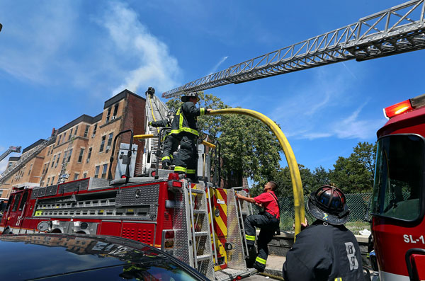 08/07/2015-Boston,MA. Boston firefighters work at the scene of a 3 alarm fire at 6 Waverly St. in Roxbury today. Staff photo by Mark Garfinkel