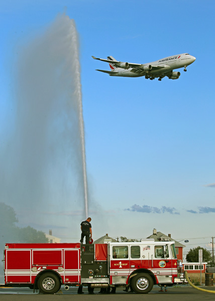 August 5, 2015. The Winthrop fire department tests a new fire engine as an Air France 747 lands in the background.