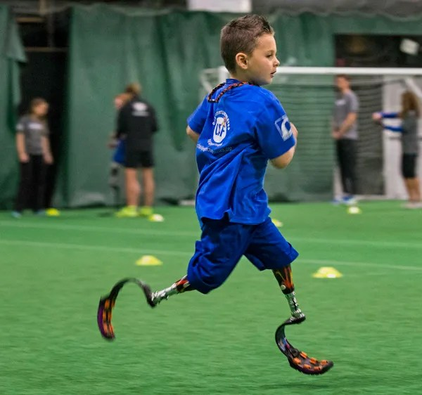 Braylon O'Neill, age 6 years, runs at the 3rd Ossur Boston Running and Mobility Clinic, Saturday morning.