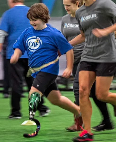 Jane Richard, who lost her leg and her brother Martin, in the Boston Marathon bombing of 2013, runs at the 3rd Ossur Boston Running and Mobility Clinic, Saturday morning.