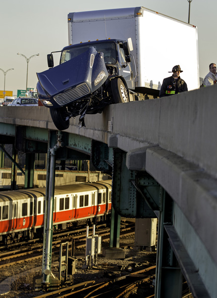 04/16/15-Boston,MA. A truck dangles over MBTA Red Line tracks and the South East Expressway, in the south bound lane, during Thursday morning's commute. The truck crash was reported to the State Police shortly after 6am.