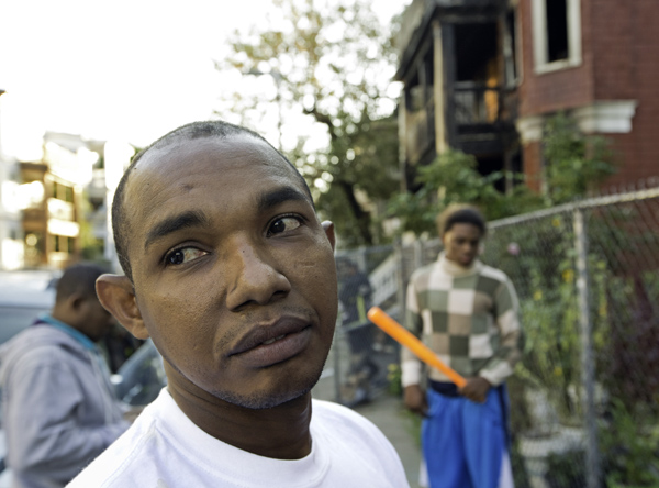 09/16/2015-Boston,MA. Daniel Diaz, a resident of 25 Ridgewood St., is seen in front of his burned-out residence hours after he was awakened by flames and heroically notified other occupants, probably saving lives at the 2 alarm fire Wednesday morning.