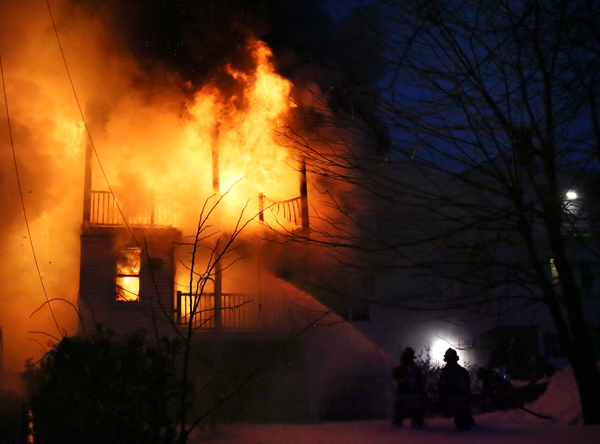 02/06/2015-Revere, MA. Firefighters battle flames, smoke and cold air at the scene of a 3 alarm fire on Reservoir Ave. Friday morning.