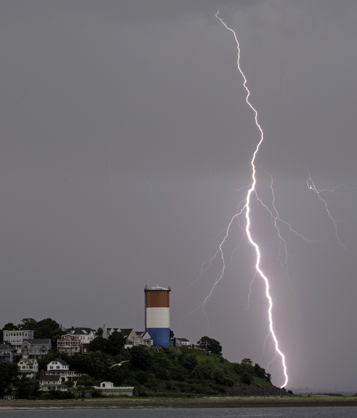 07/27/2015-Winthrop,MA. Lightning is seen over the Winthrop water tower as a line of heavy thunderstorms moved through the North Shore late Monday afternoon.Staff photo by Mark Garfinkel