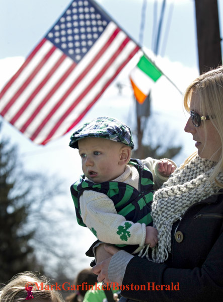 04/09/2016-Boston,MA. Terrence Patrick Boyle, age 10 months, and his mom Amy Boyle, watch the annual Shamrock Shootout Street Hockey Tournament on Temple St. in the West Roxbury section of the city, Saturday morning. Staff photo by Mark Garfinkel