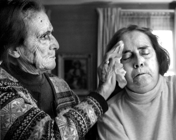 """Choosing Hospice""  - Ann O'Neill wipes moisture from the face of her daughter Maureen O'Neill. The next day Maureen would be gone.  fragm"