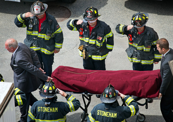 07/01/2016-Boston,MA. Stoneham firefighters salute as the body of fellow town firefighter David Atherton leaves the Boston office of the Chief Medical Examiner Friday morning. Atherton was shot and killed while off duty earlier this week. Staff photo by Mark Garfinkel.