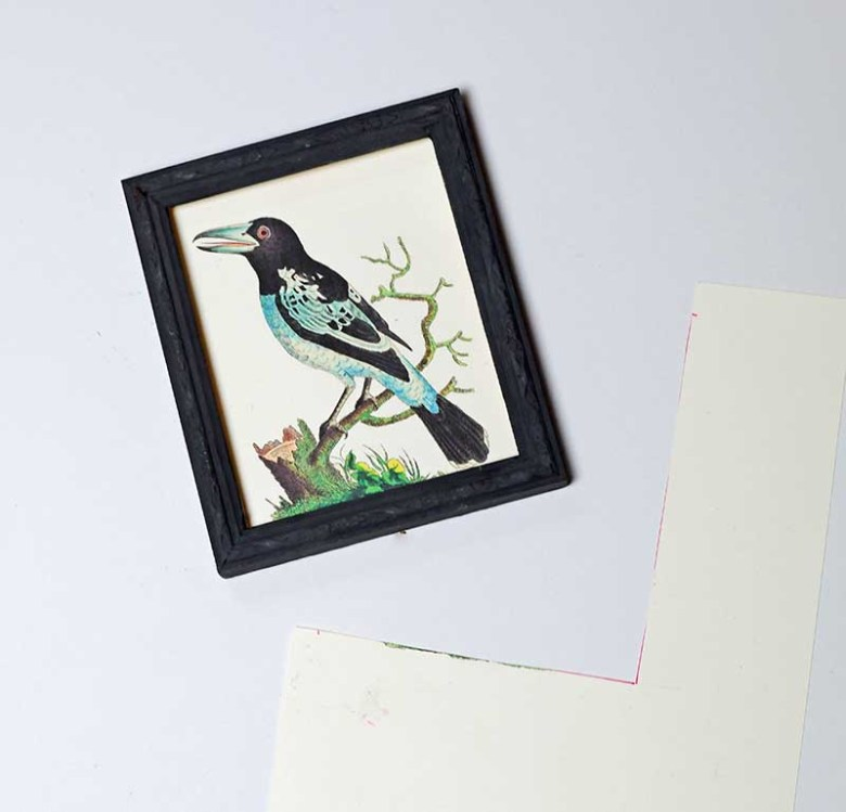 framing a picture into a painted old picture frame