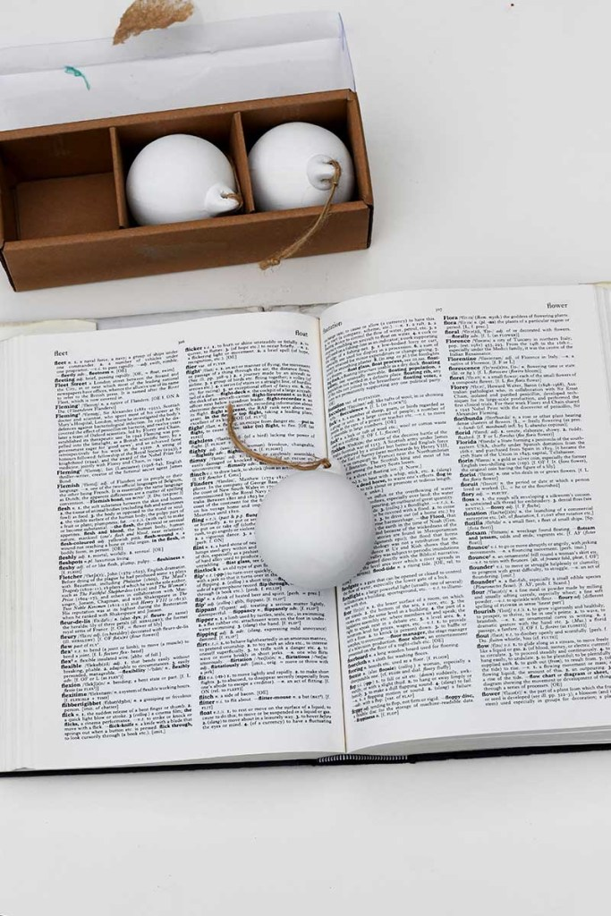 dictionary and ceramic baubles