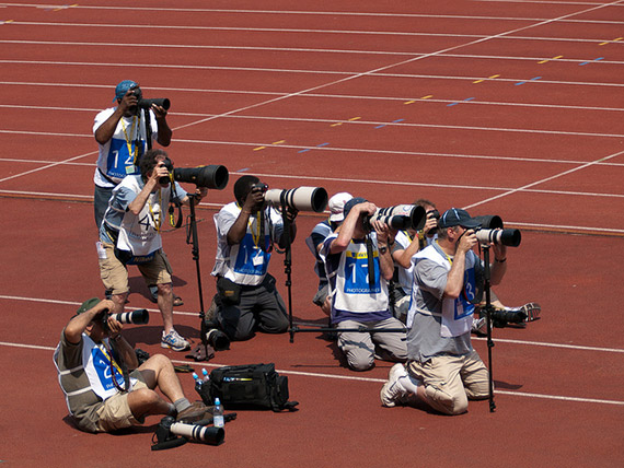 sports photographer in a group