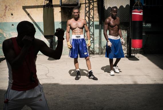 men boxing in street