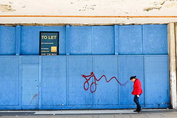 red coat street photography