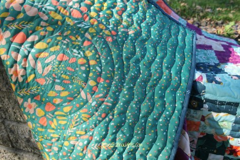 Wedding Quilt - quilting detail up close shown on back of quilt - piecefulthoughts.com