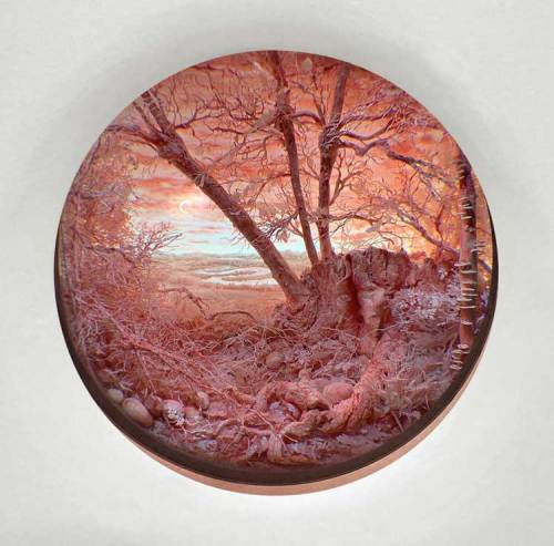 """Patrick Jacobs - """"Pink Forest with Sickle Moon,"""" 2019, Diorama viewed through 4.5"""" aperture, Styrene, acrylic, cast neoprene, paper, hair, polyurethane foam, ash, talc, starch, acrylite,  vinyl film, copper, wood, steel, lighting, BK7 glass. Concealed box dimensions: 14.5 (H) x 15.25 (W) x 12 (D) inches"""